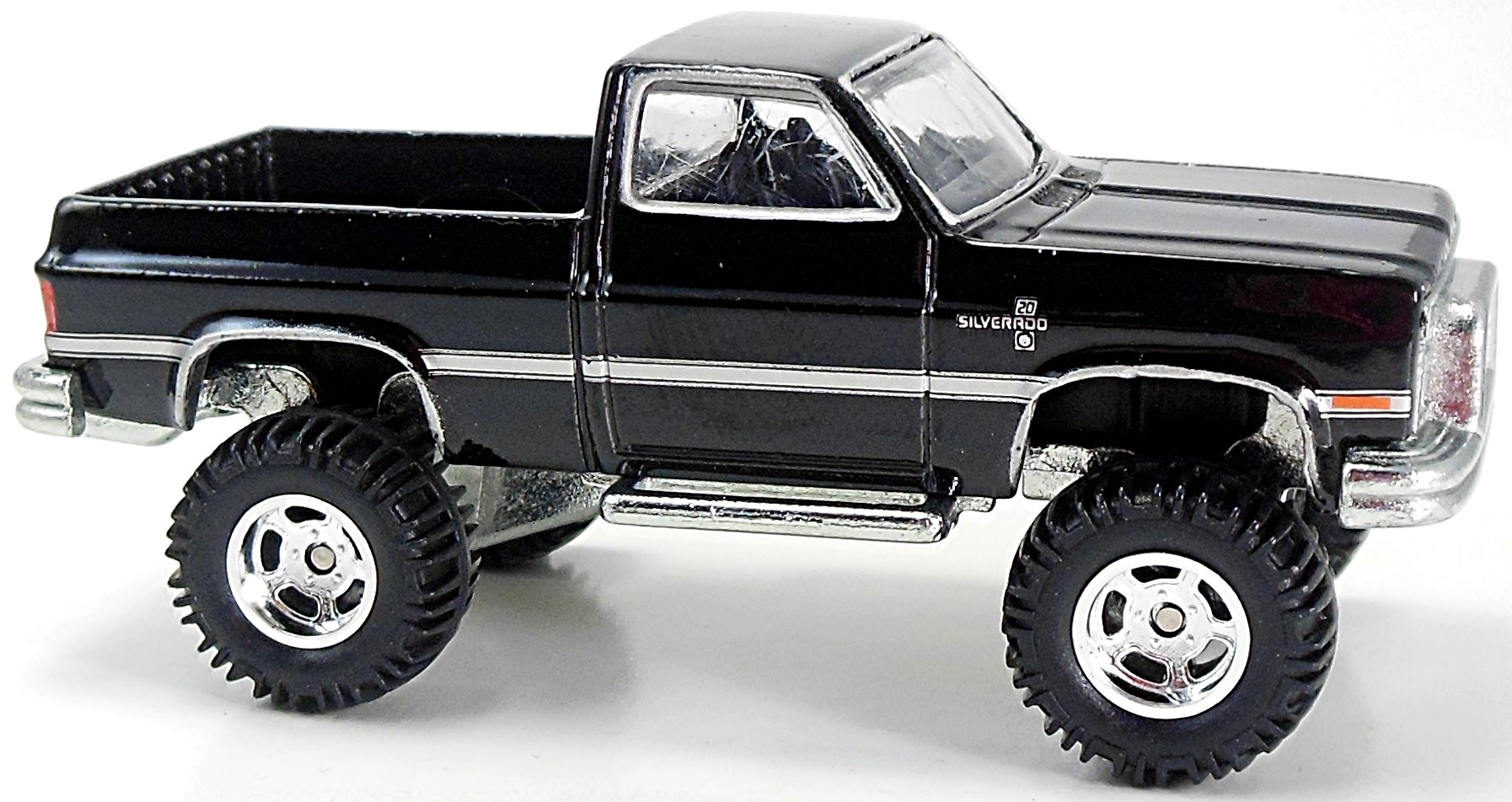 83 Chevy Silverado Lifted 79mm 2012 Hot Wheels Newsletter White